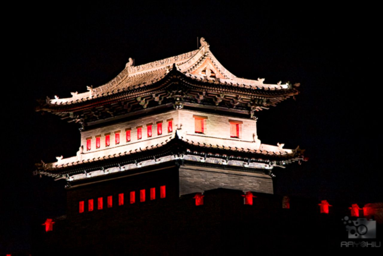 Close up of one of the structures atop Datong's city wall, lit up at night.
