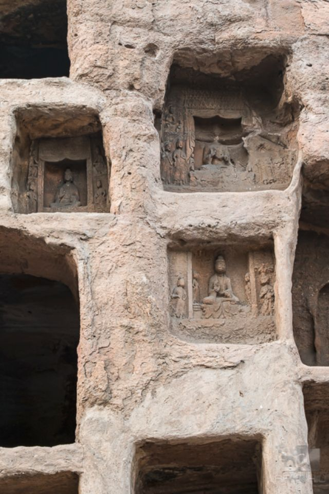 Many small to medium sized alcoves housing religious carvings or statues.