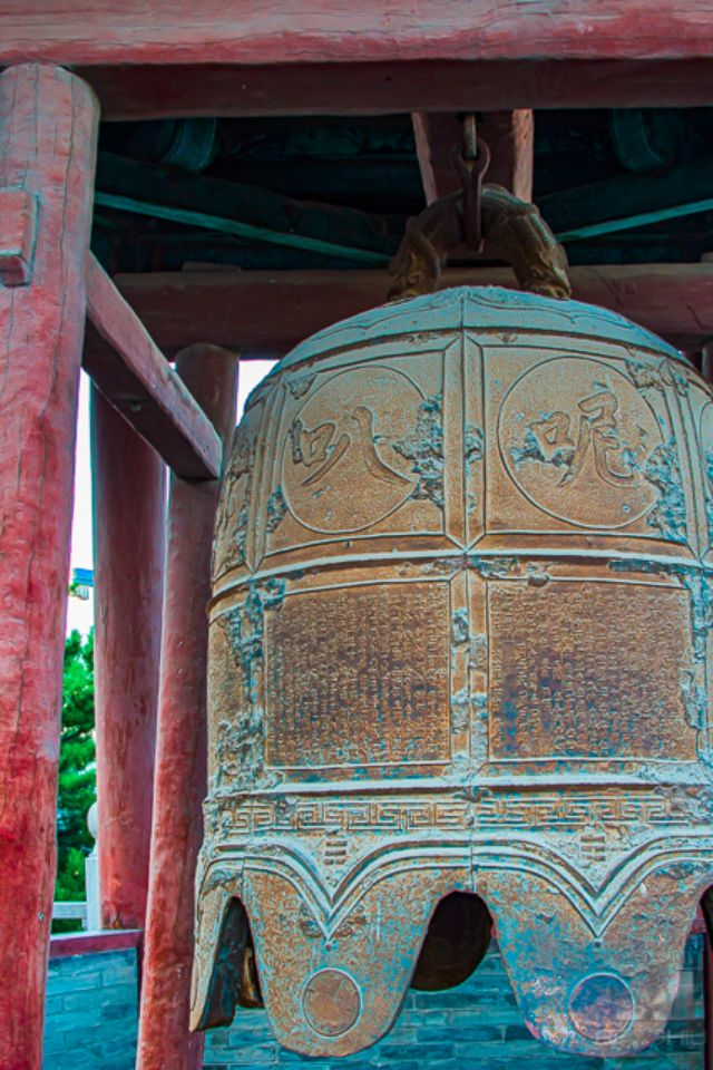 Close up of a large bell within the Huayan Temple complex