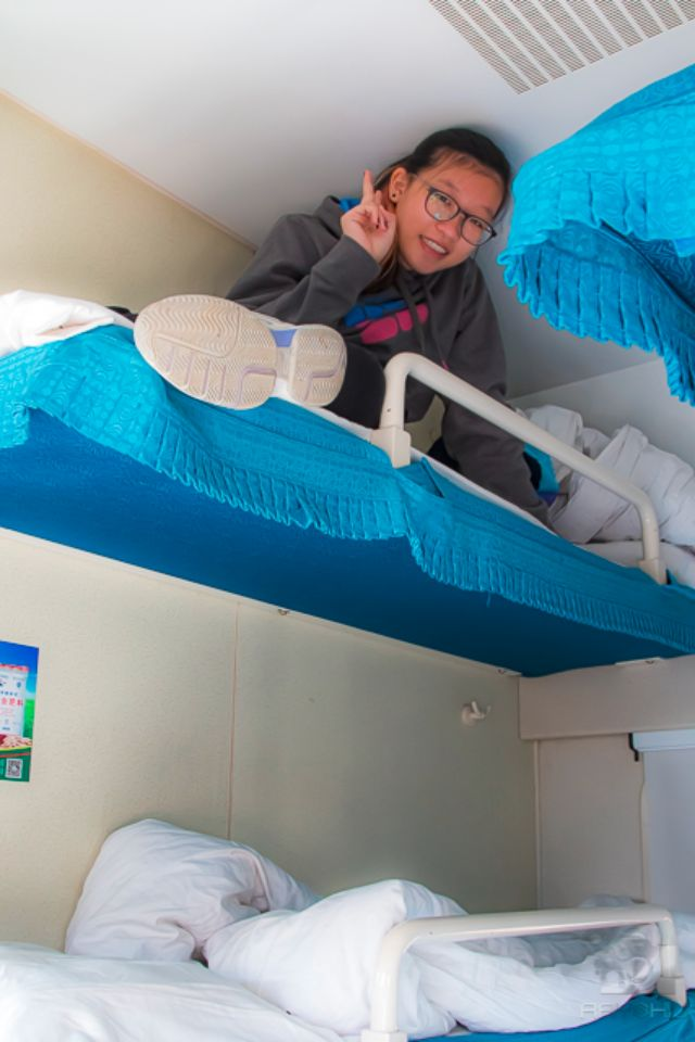 Bunk beds stacked 3 high on each side of a high speed train car in China