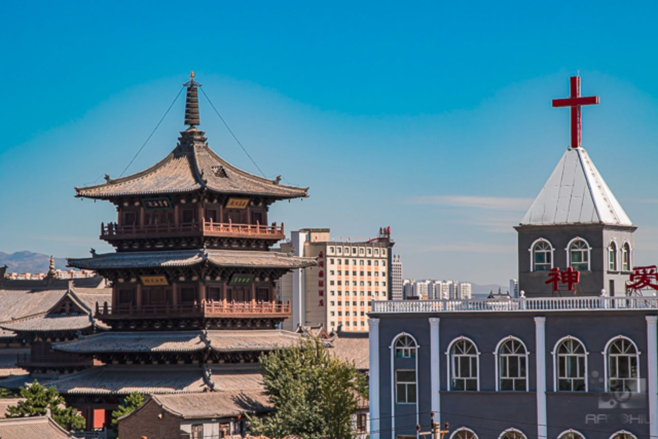 A seen from atop the the Datong Great Wall are the religious  differences in Datong Society.