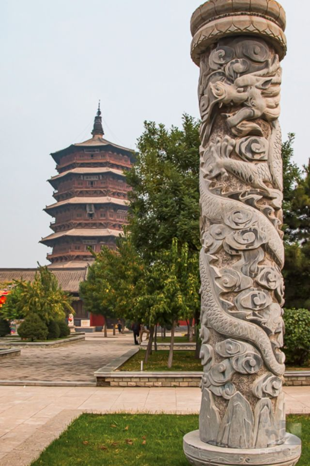 A dragon carved into a pillar at the plaza of the Wooden Pagoda