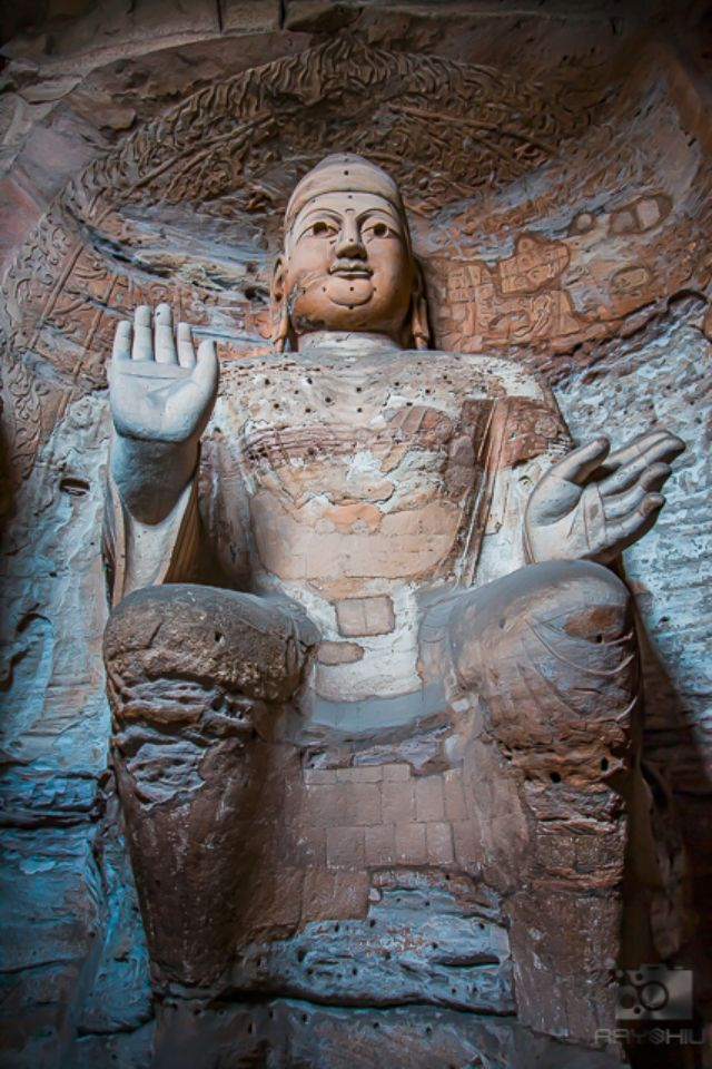 Giant stone Buddha scultpures in one of the main caves at the Yungang Grottos.
