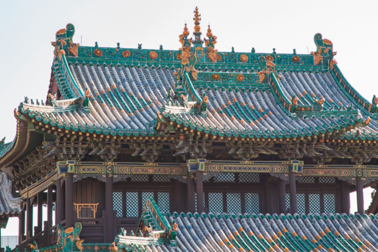 Close up of an ornate roof top of a temple