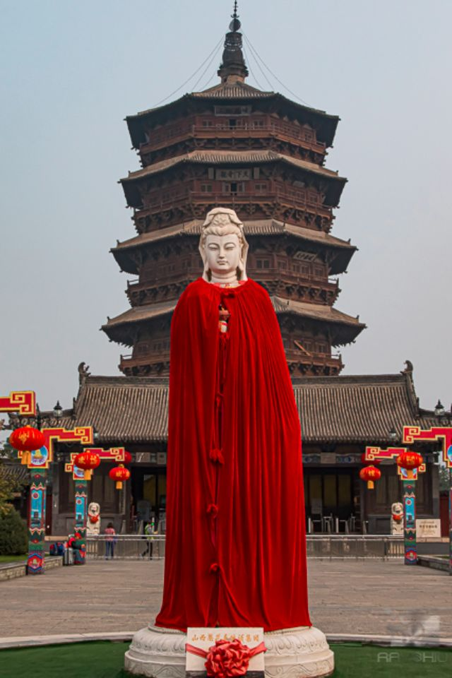 A red robe placed around the Buddha Sakyamuni statue in front of the Yingxian Wooden Pagoda.