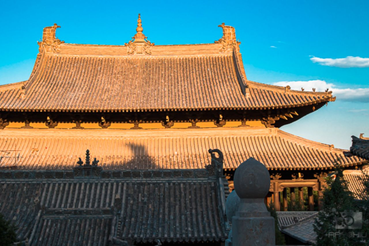Sunset on a temple's roof at the Huayan Monastery in Datong, China.