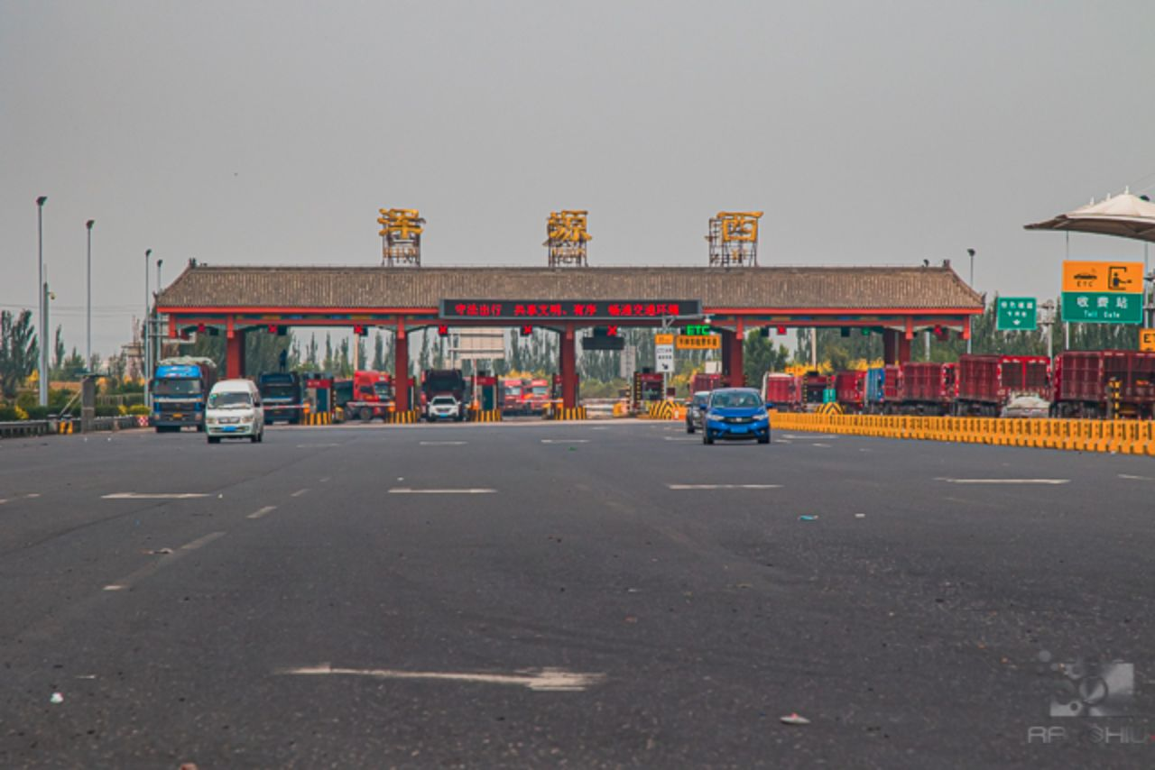 Toll gate in China as seen from the back of a taxi