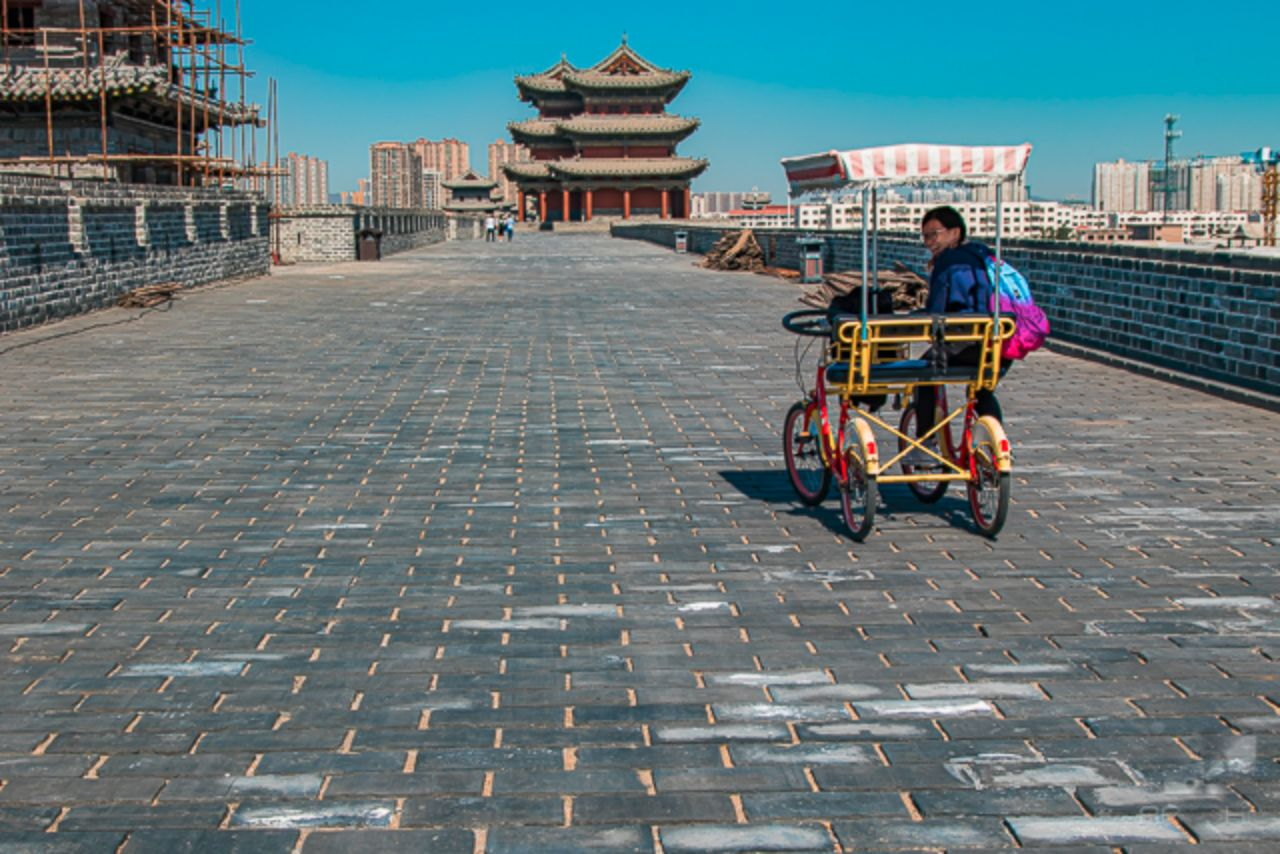 Biking on Datong's Great Wall.