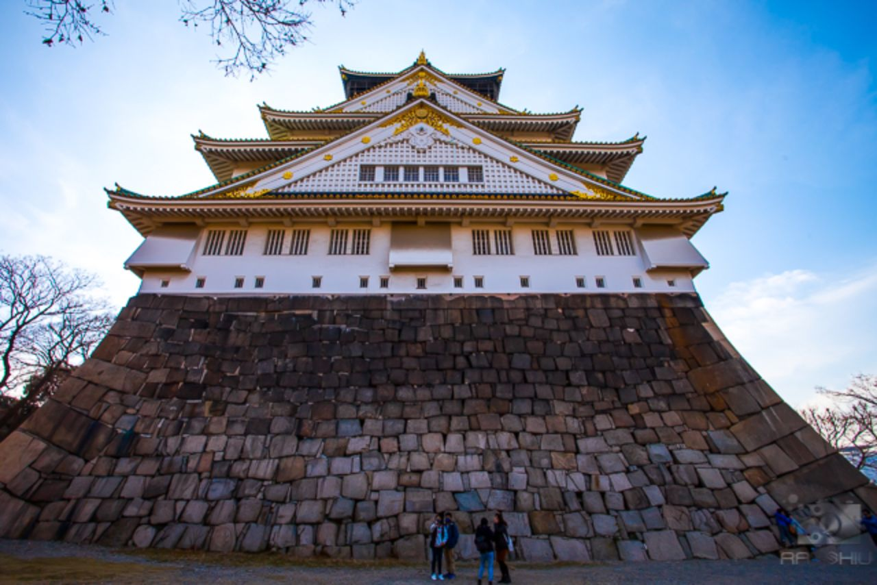 Standing in the shadow of Osaka Castle